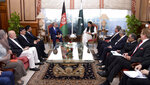 In this photo provided by the Press Information Department, Abdullah Abdullah, center left, chairman of Afghanistan's High Council for National Reconciliation, meets with Pakistan's Prime Minister Imran Khan, in Islamabad, Pakistan, Tuesday, Sept. 29, 2020. Abdullah said that the time has come for the two neighboring countries to shun the suspicion,