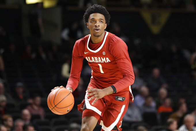 FILE - In this Jan. 22, 2020, file photo, Alabama forward Herbert Jones plays against Vanderbilt in the first half of an NCAA college basketball game in Nashville, Tenn. Alabama senior Herbert Jones is The Associated Press player of the year in the Southeastern Conference and a member of the All-SEC first team in voting announced Tuesday, March 9, 2021. (AP Photo/Mark Humphrey, File)