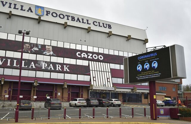 """FILE - This Saturday, Nov. 21, 2020 file photo shows a general view of a social distancing message on display outside the Villa Park stadium, home of Aston Villa, in Birmingham, England. Aston Villa has on Thursday, Jan. 7, 2021 reported a """"significant"""" coronavirus outbreak and closed its training ground a day before a scheduled FA Cup home game against Liverpool. Villa says """"discussions are ongoing between medical representatives of the club, the Football Association and the Premier League."""" (AP Photo/Rui Vieira, file)"""