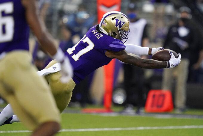 Washington wide receiver Taj Davis dives for a touchdown during the first half of an NCAA college football game against California, Saturday, Sept. 25, 2021, in Seattle. (AP Photo/Elaine Thompson)