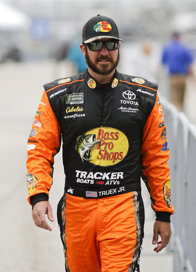 Martin Truex Jr. walks down pit road during qualifying for the Daytona 500 auto race at Daytona International Speedway, Sunday, Feb. 10, 2019, in Daytona Beach, Fla. (AP Photo/Terry Renna)
