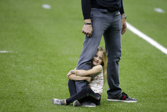 New Orleans Saints quarterback Drew Brees plays with his daughter Rylen Brees after an NFL divisional round playoff football game against the Tampa Bay Buccaneers, Sunday, Jan. 17, 2021, in New Orleans. The Tampa Bay Buccaneers won 30-20. (AP Photo/Butch Dill)