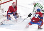 Dallas Stars' Jason Dickinson (18) moves in on Montreal Canadiens goaltender Carey Price as Canadiens' Victor Mete (53) defends during the second period of an NHL hockey game Saturday, Feb. 15, 2020, in Montreal. (Graham Hughes/The Canadian Press via AP)