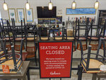 FILE - In this March 26, 2020, file photo, an indoors sitting bar is closed inside the Gelson's Market in the Los Feliz neighborhood of Los Angeles.   Newsom suffered political backlash after it surfaced that he and his wife attended a party Nov. 6, 2020, with a dozen friends at the pricy French Laundry restaurant in wine country north of San Francisco. Newsom is facing the second recall of a governor in California history and the last day to vote is Sept. 14, 2021. (AP Photo/Damian Dovarganes, File)
