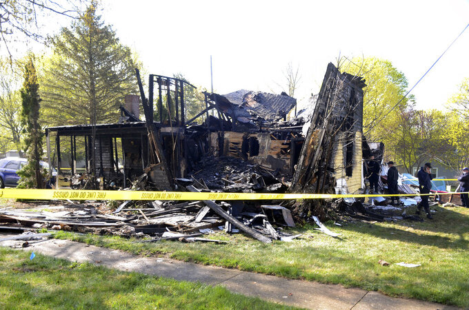 An explosion destroyed a house Monday, April 12, 2021, in Marshall, Mich. Eight people were taken to hospitals. Authorities believe a natural gas leak might have been the cause. Marshall Fire Chief Martin Erskine said all eight were taken to either Bronson Methodist Hospital in Kalamazoo or Oaklawn Hospital in Marshall, with some believed to have serious injuries. He said officials are gathering information on their identities and medical conditions. (Trace Christenson/Battle Creek Enquirer via AP)
