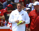 FILE - In this April 21, 2018, file photo, former Tennessee coach Butch Jones, now an analyst for Alabama, watches from the sidelines during the first half of the Crimson Tide's spring NCAA college football game in Tuscaloosa, Ala. The top-ranked Crimson Tide face Tennessee on Saturday.(AP Photo/Butch Dill, File)