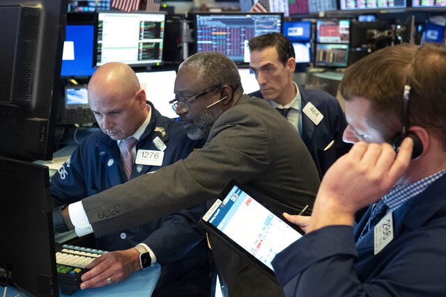 Traders at the New York Stock Exchange work as the market closes, Wednesday, March 18, 2020 in New York. (AP Photo/Mark Lennihan)