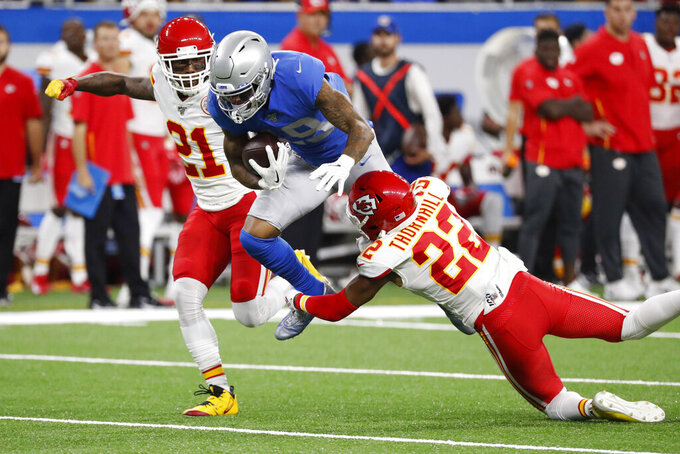 Detroit Lions wide receiver Kenny Golladay (19) is tackled by Kansas City Chiefs free safety Juan Thornhill (22) during the first half of an NFL football game, Sunday, Sept. 29, 2019, in Detroit. (AP Photo/Rick Osentoski)