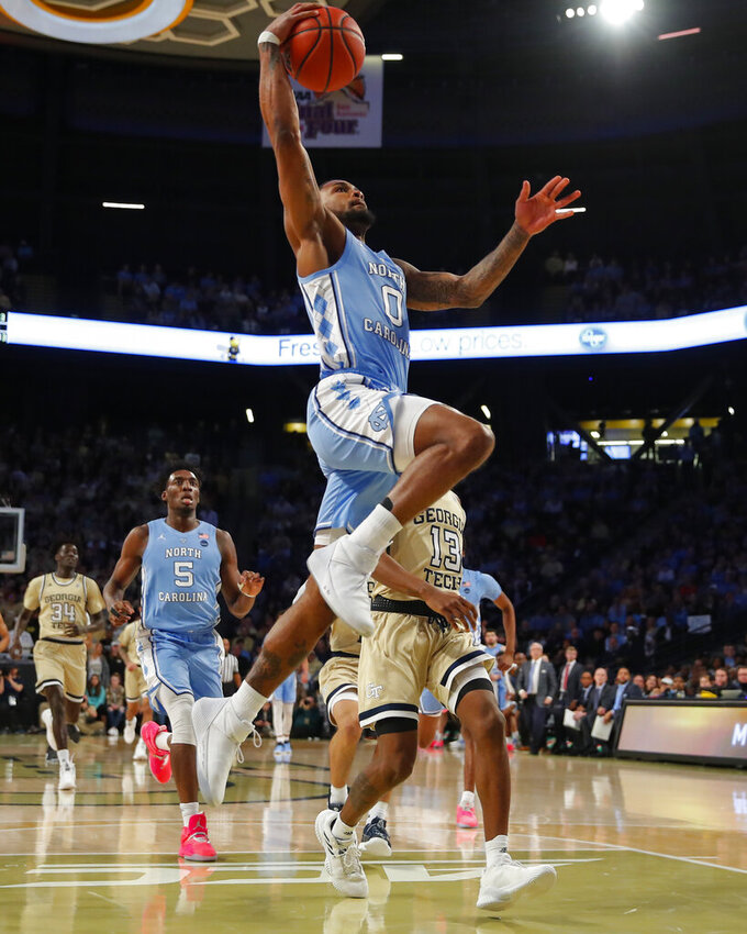 North Carolina guard Seventh Woods (0) dunks during the first half of an NCAA college basketball game against Georgia Tech in Atlanta, Tuesday, Jan. 29, 2019. (AP Photo/Todd Kirkland)
