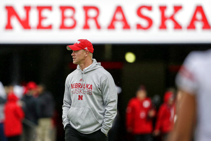 In this Sept. 28, 2019, photo, Nebraska head coach Scott Frost follows his players warming up before an NCAA college football game against Ohio State in Lincoln, Neb. The Cornhuskers have underachieved in a season in which they were a popular pick to win the Big Ten West. They are 4-4 and well behind Minnesota in the West race. Tension is palpable inside and outside the program. (AP Photo/Nati Harnik)