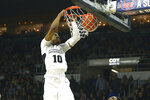 Providence's A.J. Reeves (10) dunks the ball during the second half of an NCAA college basketball game against Creighton Wednesday, Feb. 5, 2020, in Providence, R.I. (AP Photo/Stew Milne)
