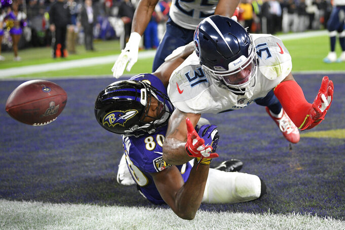 Baltimore Ravens wide receiver Miles Boykin (80) misses the catch on a two-point conversion against Tennessee Titans free safety Kevin Byard (31) during the second half of an NFL divisional playoff football game, Saturday, Jan. 11, 2020, in Baltimore. (AP Photo/Nick Wass)