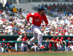 Boston Red Sox' Dustin Pedroia runs to first with a base hit in the first inning of a spring training baseball game against the Detroit Tigers Tuesday, March 12, 2019, in Fort Myers, Fla. (AP Photo/John Bazemore)