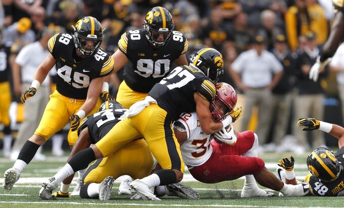 FILE - In this Sept. 8, 2018, file photo, Iowa defensive back Amani Hooker, center, tackles Iowa State running back David Montgomery, right, during the first half of an NCAA college football game,in Iowa City, Iowa. The 18th-ranked Wisconsin Badgers (2-1) haven't been the dominant team everyone expected them to be and, following their home loss to BYU, are looking to reset the season in their Big Ten opener against Iowa. Iowa (3-0) has been one of the most dominant defensive teams in the nation. (AP Photo/Matthew Putney, File)