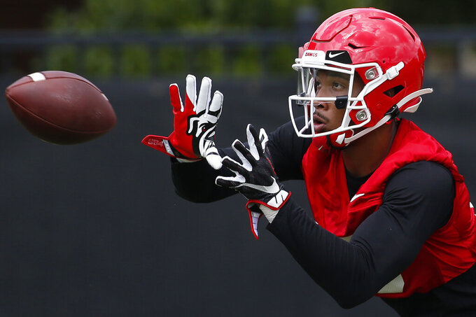 FILE - In this Aug. 2, 2019, file photo, Georgia wide receiver Lawrence Cager looks to bring a catch during an NCAA football preseason practice in Athens, Ga. Cager left Miami after catching 21 passes for 374 yards and six touchdowns. Georgia has lost its top five receivers from last year, so Cager will have plenty of opportunity to make an impact. (Joshua L. Jones/Athens Banner-Herald via AP)