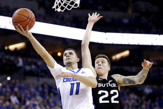 Creighton's Marcus Zegarowski (11) goes for a layup sgainst Butler's Sean McDermott (22) during the second half of an NCAA college basketball game in Omaha, Neb., Sunday, Feb. 23, 2020. (AP Photo/Nati Harnik)