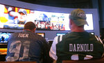 This Sept. 9, 2018 photo shows fans of the New York Giants and Jets watching a football game after placing bets in the sports betting lounge at the Ocean Casino Resort in Atlantic City, N.J. Despite a push from lawmakers favoring it, New York state is unlikely to offer mobile sports betting anytime soon, leaving much of the populous New York metropolitan region to New Jersey and Pennsylvania sports books. (AP Photo/Wayne Parry)