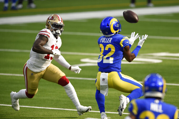Los Angeles Rams strong safety Jordan Fuller, right, intercepts a pass during the first half of an NFL football game against the San Francisco 49ers Sunday, Nov. 29, 2020, in Inglewood, Calif. (AP Photo/Kelvin Kuo)