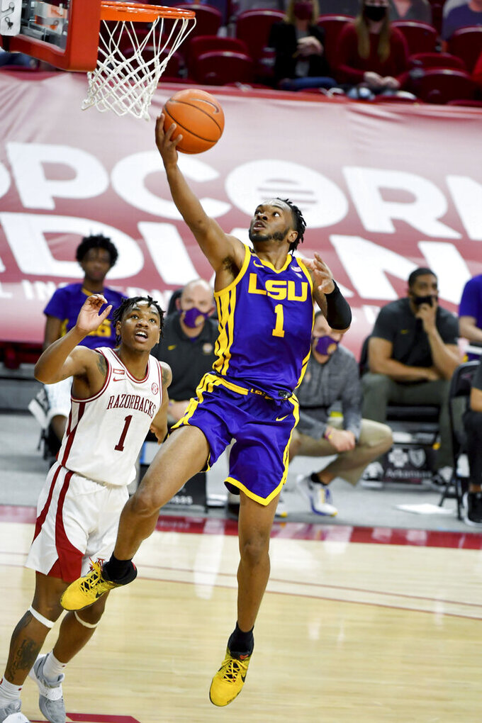 LSU guard Ja'Vonte Smart (1) drives to the hoop against Arkansas guard JD Notae (1) during the first half of an NCAA college basketball game in Fayetteville, Ark. Saturday, Feb. 27, 2021. (AP Photo/Michael Woods)