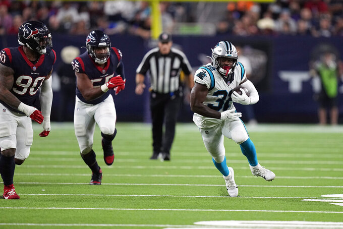 Carolina Panthers running back Royce Freeman (32) rushes for a gain against the Houston Texans during the second half of an NFL football game Thursday, Sept. 23, 2021, in Houston. (AP Photo/Eric Christian Smith)