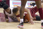 Boston College's Julian Rishwain, right, wrestles with Florida State's Malik Osborne for a loose ball in the second half of an NCAA college basketball game Saturday, March 7 2020, in Tallahassee, Fla. Florida State won 80-62. (AP Photo/Steve Cannon)