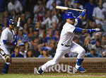 Chicago Cubs' Javier Baez watches his RBI single during the sixth inning of the team's baseball game against the San Francisco Giants on Wednesday, Aug 21, 2019, in Chicago. (AP Photo/Paul Beaty)
