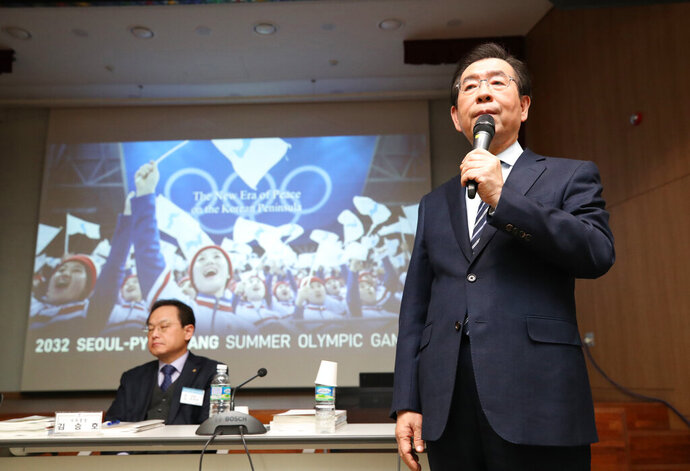 Seoul Mayor Park Won-soon, right, speaks during the Korean Sport & Olympic Committee general assembly at the National Training Center in Jincheon, South Korea, Monday, Feb. 11, 2019. South Korea has chosen its capital, Seoul, for its bid for the 2032 Summer Olympics, which it hopes to jointly host with rival North Korea as a peace gesture. (Kim In-chul/Yonhap via AP)
