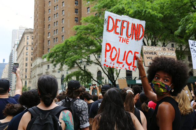 Protesters march Saturday, June 6, 2020, in New York. Demonstrations continue across the United States in protest of racism and police brutality, sparked by the May 25 death of George Floyd in police custody in Minneapolis. (AP Photo/Ragan Clark)