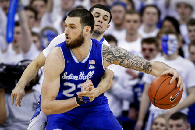 FILE - In this March 7, 2020, file photo, Creighton's Marcus Zegarowski, rear, reaches for the ball against Seton Hall's Sandro Mamukelashvili (23), during the second half of an NCAA college basketball game in Omaha, Neb. Mamukelashvili has opted out of the NBA draft and is returning to Seton Hall for his senior year.  (AP Photo/Nati Harnik, File)