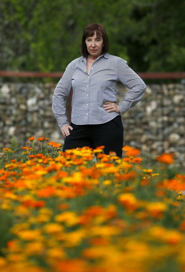 Arizona caterer Pat Christofolo, who owns Artisan by Santa Barbara Catering as well as The Farm at South Mountain, pauses at a large garden on property at The Farm has had business drop off due to the coronavirus shown here Wednesday, April 1, 2020, in Phoenix. (AP Photo/Ross D. Franklin)