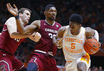 Tennessee guard Admiral Schofield (5) drives as he's defended by South Carolina forward Chris Silva (30) and forward Felipe Haase (13) during the second half of an NCAA college basketball game Wednesday, Feb. 13, 2019, in Knoxville, Tenn. Tennessee won 85-73. (AP photo/Wade Payne)