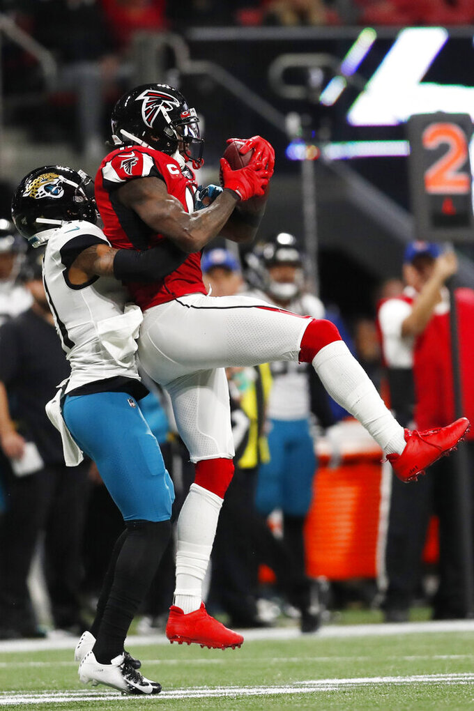 Jacksonville Jaguars cornerback A.J. Bouye (21) hits Atlanta Falcons wide receiver Julio Jones (11) during the first half of an NFL football game, Sunday, Dec. 22, 2019, in Atlanta. (AP Photo/John Bazemore)