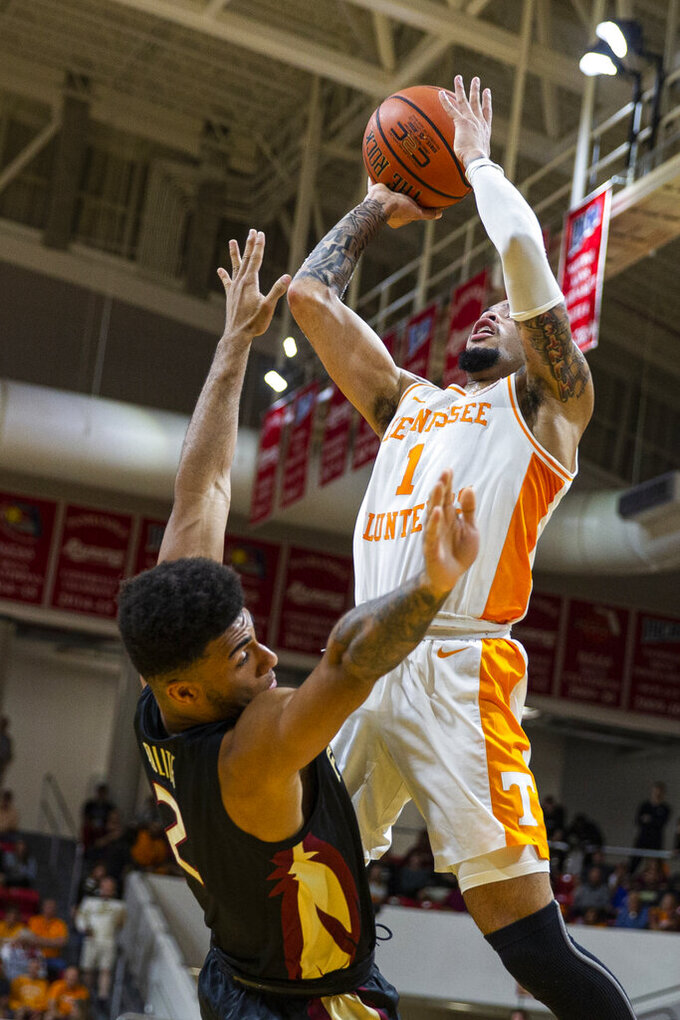 Tennessee guard Lamonte Turner (1) is charged with an offensive charging foul against Florida State guard Anthony Polite (2) in the first half of an NCAA college basketball game at the Emerald Coast Classic in Niceville, Fla., Friday, Nov. 29, 2019. (AP Photo/Mark Wallheiser)