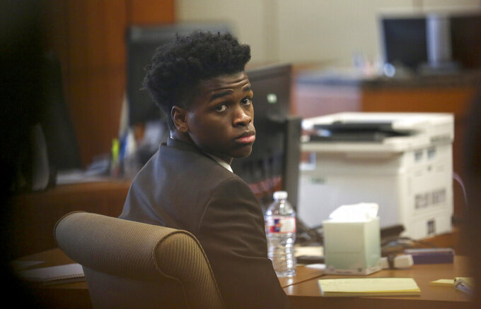 Antonio Armstrong, Jr. waits for court session to resume after opening arguments were delivered in the 178th Criminal Court Tuesday, April 2, 2019, in Houston. Armstrong Jr. faces capital murder charges for allegedly murdering his parents as they slept in their Bellaire home in 2016. (Godofredo A. Vasquez/Houston Chronicle via AP)