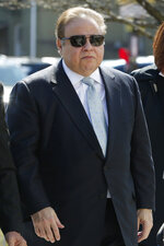 FILE - In this April 2, 2015 file photo, Dr. Salomon Melgen arrives at the Martin Luther King Jr. Federal Courthouse for his arraignment in Newark, N.J. The prominent Florida eye doctor, convicted of defrauding Medicare out of $73 million, got out of prison early after former President Donald Trump commuted his sentence just hours before his term ended. (AP Photo/Julio Cortez, File)