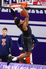 Northwestern guard Anthony Gaines dunks during the first half of the team's NCAA college basketball game against Illinois in Evanston, Ill., Thursday, Jan. 7, 2021. (AP Photo/Nam Y. Huh)