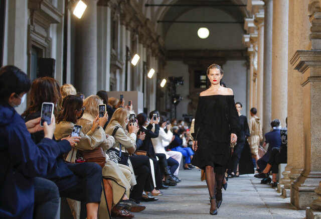 A model wears a creation as part of the Max Mara 2021 women's spring-summer ready-to-wear collection during the Milan's fashion week in Milan, Italy, Thursday, Sept. 24, 2020. (AP Photo/Antonio Calanni)