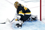 Boston Bruins goaltender Tuukka Rask (40) makes a save against the Pittsburgh Penguins during the second period of an NHL hockey game, Tuesday, Jan. 26, 2021, in Boston. (AP Photo/Charles Krupa)