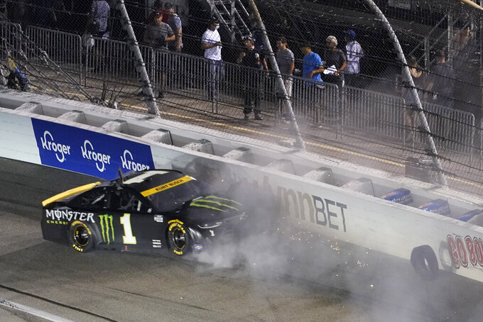 Kurt Busch loses a tire and scrubs the wall during the NASCAR Cup series auto race in Richmond, Va., Saturday, Sept. 11, 2021. (AP Photo/Steve Helber)