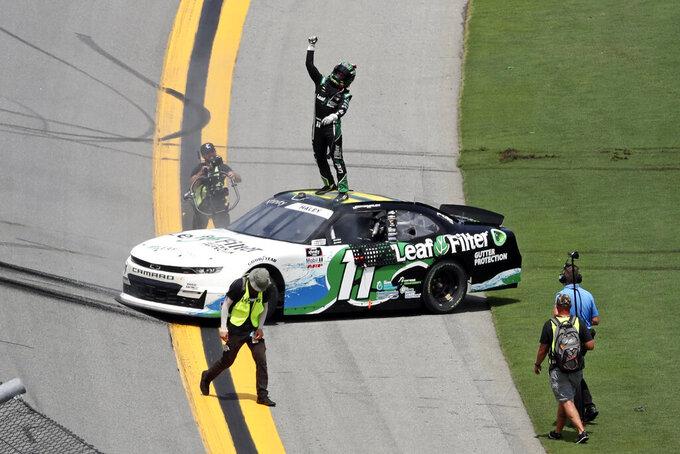 Justin Haley celebrates on the roof of his car after winning the NASCAR Xfinity Series auto race at Daytona International Speedway, Saturday, Aug. 28, 2021, in Daytona Beach, Fla. (AP Photo/David Graham)