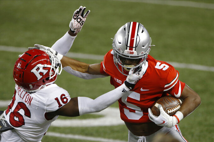 Rutgers defensive back Max Melton, left, tries to tackle Ohio State receiver Garrett Wilson during the first half of an NCAA college football game Saturday, Nov. 7, 2020, in Columbus, Ohio. (AP Photo/Jay LaPrete)