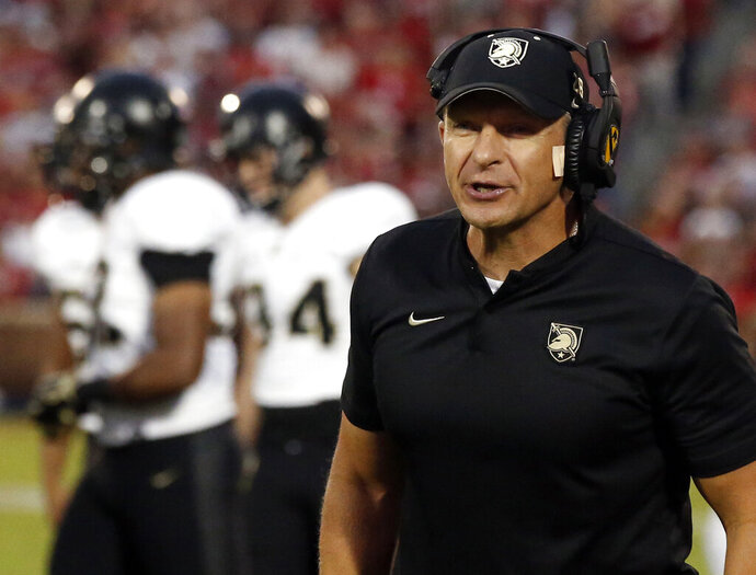 FILE - In this Sept. 22, 2018, file photo, Army head coach Jeff Monken shouts in the first half of an NCAA college football game against Oklahoma in Norman, Okla. College football coaches are facing the daunting challenge of getting their players to maintain the required focus to prepare for season-openers when the prevailing question swirling around the sport is when, or if, the season will even be played because of the worldwide coronavirus pandemic. (AP Photo/Sue Ogrocki, File)