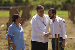 Mexican Chancellor Marcelo Ebrard, center, shakes hands with the President of El Salvador Nayib Bukele, while Alexandra Hill, Salvadoran Chancellor, observes them after the official launch of the