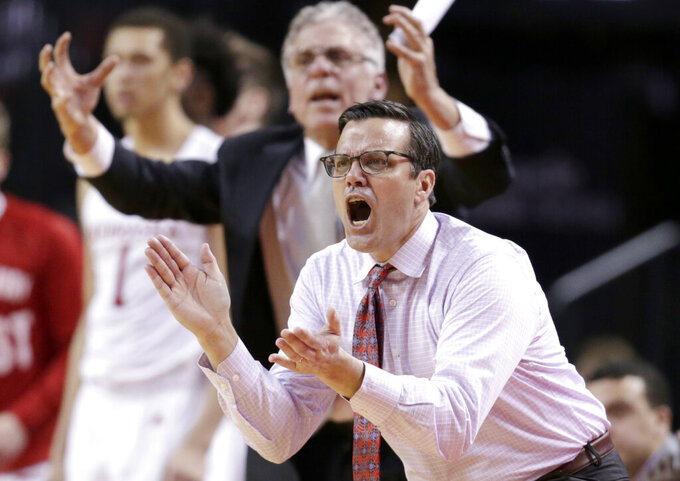Nebraska coach Tim Miles urges his team on, during the second half of an NCAA college basketball game against Purdue in Lincoln, Neb., Saturday, Feb. 23, 2019. (AP Photo/Nati Harnik)