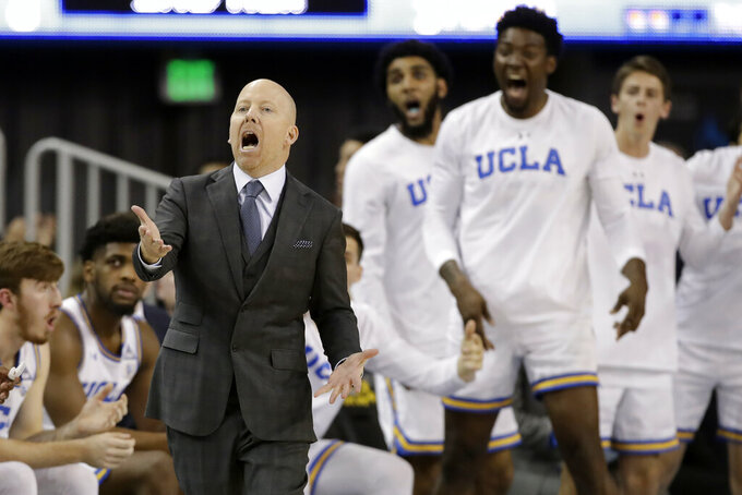 FILE - In this Thursday, Feb. 13, 2020, file photo, UCLA coach Mick Cronin argues a call during the second half of the team's NCAA college basketball game against Washington State, in Los Angeles. Cronin earned Pac-12 coach of the year honors for the 2019-20 season. (AP Photo/Marcio Jose Sanchez, File)