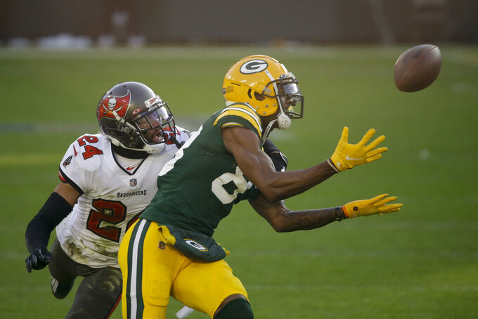 Green Bay Packers' Marquez Valdes-Scantling makes a 50-yard touchdown catch against Tampa Bay Buccaneers' Carlton Davis during the first half of the NFC championship NFL football game in Green Bay, Wis., Sunday, Jan. 24, 2021. (AP Photo/Mike Roemer)