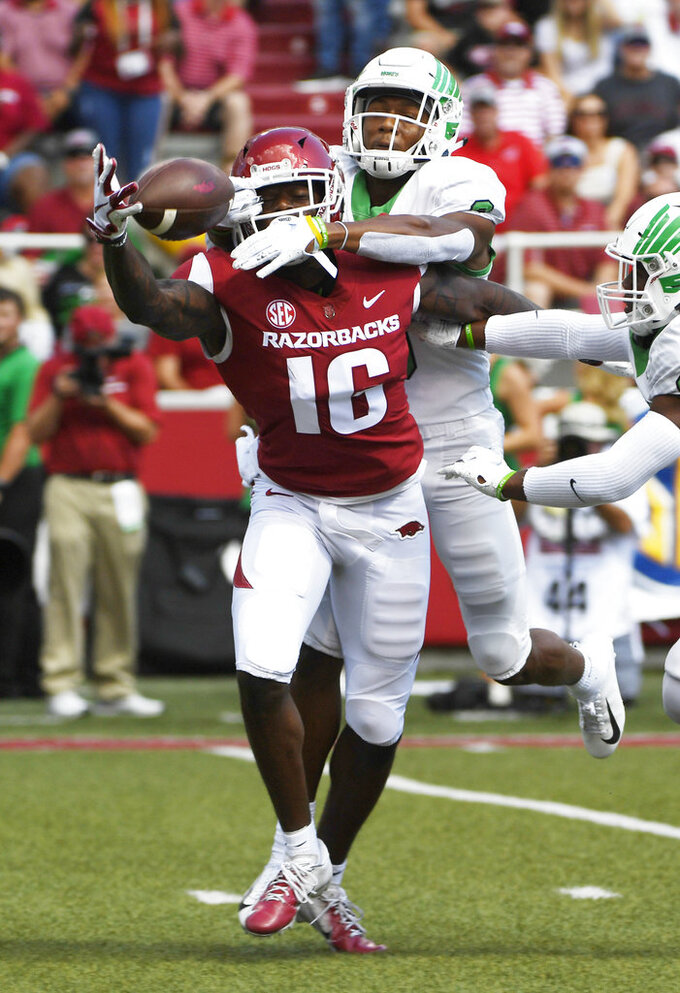 North Texas defender Nate Brooks, top, breaks up a pass intended fo Arkansas receiver La' Michael Pettway in the first half of an NCAA college football game Saturday, Sept. 15, 2018, in Fayetteville, Ark. (AP Photo/Michael Woods)