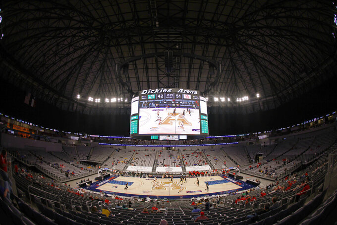 Houston plays Tulane at Dickies Arena during the second half of an NCAA college basketball game in the quarterfinals of the American Athletic Conference men's tournament Friday, March 12, 2021, in Fort Worth, Texas. (AP Photo/Ron Jenkins)