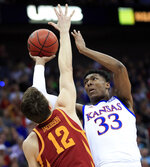 Kansas forward David McCormack (33) shoots over Iowa State forward Michael Jacobson (12) during the first half of an NCAA college basketball game in the finals of the Big 12 men's tournament in Kansas City, Mo., Saturday, March 16, 2019. (AP Photo/Orlin Wagner)