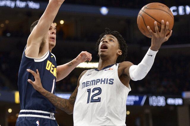 Memphis Grizzlies guard Ja Morant (12) shoots against Denver Nuggets forward Michael Porter Jr. (1) in the second half of an NBA basketball game Tuesday, Jan. 28, 2020, in Memphis, Tenn. (AP Photo/Brandon Dill)